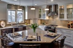 Soft white cabinetry, subway tiles, and a larger window all helped to create thi