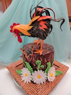 Birthday Cakes - Rooster is rkt covered in fondant reinforced with chocolate.  Cake is yellow- chocolate-yellow with peanut butter cream cheese buttercream and chopped pb cups.  Cake has pb buttercream crumb coat with chocolate ganache.  I used a wooden skewer to mark ganache and create wood grain on tree stump.