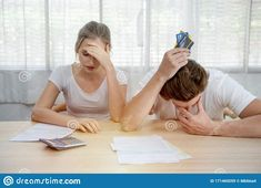 Young caucasian couple hand holding credit card and debt bill on table in home,men and women have overdue financial foreclosure problem sit in room with serious and unhappy payment. Hand Holding, Holding Hands, Couple Hands, Men And Women, Economics, Debt, Couples, Table, Room