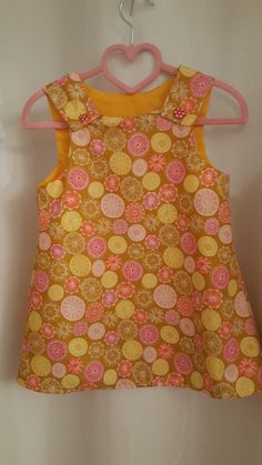 My own Sewing. Pinafore Dress for Little Girls with 2 buttons on the front