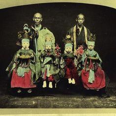 Buddhist monks with children. Meiji Period. Japan.