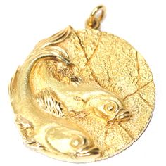 Tiffany Pisces Zodiac Medallion | From a unique collection of vintage drop necklaces at http://www.1stdibs.com/jewelry/necklaces/drop-necklaces/