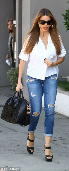 Designer extras: The Modern Family star carried a very expensive gym bag, namely a leopard print Givenchy Antigona handbag