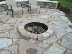 Flagstone patio with firepit - this could work in my back yard.  Replace the crossties with the rock wall!