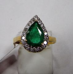 14 CT SOLID GOLD, GENUINE DIAMOND & Emerald SET RING . 14 CT GOLD WEIGHT-2.840 GMS ,USA RING SIZE-7 (WE CAN ADJUST SIZE), SIZE OF TOP-12/15 MM, Emerald WEIGHT- 2.50 CT, DIAMOND WEIGHT-0.40 CT, DIAMOND DETAIL-CENTER CLEAN, BELGIUM CUT,WHITE-GH, PURITY-VS.