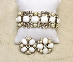 Vintage Milk Glass Aurora Borealis AB Rhinestone Bracelet Earrings is a simply stunning set!  The bracelet is designed with a center row of rectangular milk glass cabochons.  On each side of the cente