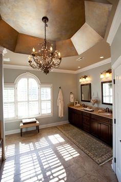 traditional master bathroom by Loftus Design.  Faux finish vaulted ceiling. Crystal chandelier