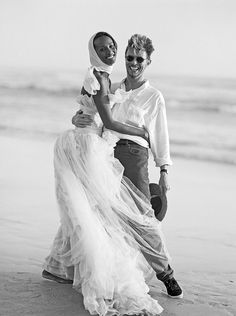 """nightswimming: """" Iman (dress by Karl Lagerfeld for Chanel Haute Couture) and David Bowie on the beach at Cape Point Nature Reserve near Cape Town, South Africa. Photographed by Bruce Weber, Vogue,. Bruce Weber, Happy Together, Celebrity Wedding Dresses, Celebrity Weddings, Ansel Adams, Dona Summer, Iman And David Bowie, Iman Bowie, Karl Otto"""