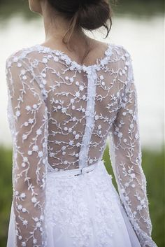 Pure by AtelierDeCouture...Holy cow I LOVE this back. If I ever did an outdoor winter wedding, this would be my dress.
