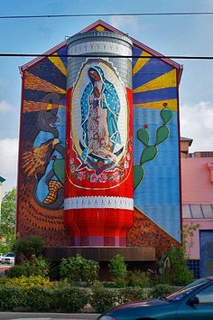 In 2006, nationally-renowned San Antonio artist, Jesse Trevino, completed the three-dimensional, 40-foot mosaic La Veladora of Our Lady of Guadalupe on the side of the Guadalupe Cultural Arts Center building that was dedicated to the victims of the 9/11 attacks. The ceramic mural includes a 3-dimensional candle with an eternal flame facing Guadalupe Street.  The flame is intended to serve as a neighborhood beacon.