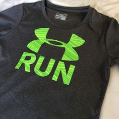 UA heat gear top {small} Like new gray UA top with lime green logo. Semi-fitted. It's lightweight and comfortable. Goes great with yoga leggings. Under Armour Tops