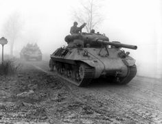 """M36 """"Jackson"""" tank destroyers moving up to support the 82 Airborne early in the Battle of the Bulge, Belgium, Dec 1944."""