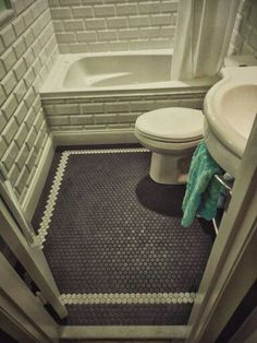 "Bathroom Floor 1"" Black Matte Hex Tile /w border of 1"" White Matte Hex Tile from Daltile"
