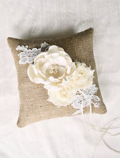 As exquisite as it is unique, this lovely ring bearer pillow is made with burlap and is fully lined. A gorgeous handmade ivory satin flower is Ring Bearer Pillows, Ring Pillows, Burlap Pillows, Rustic Wedding, Our Wedding, Dream Wedding, Wedding Rings, Camo Wedding, Wedding Ideas