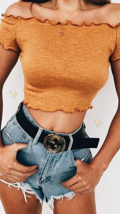 Gold off the shoulder top with denim shorts.