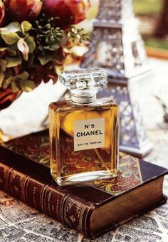 chanel no 5.. Its the first real parfume i ever wore.. stilll so womanly, classic & elegant.. thanks Coco.