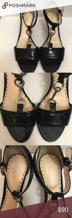 "Coach black and silver leather strappy sandals Coach sandals with 2.25"" heels. Buckles on outside ankle straps. Metal detail on top of foot. Excellent condition with wear on soles. Coach Shoes Sandals"