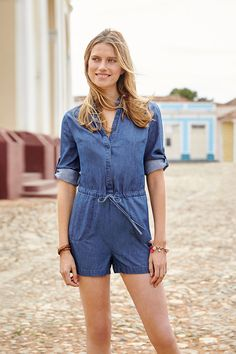 We're putting the 'play' in playsuit with this ultra-relaxed casual number. Made from drapey, denim-look Tencel fabric, this playsuit has tons of versatile details: an above-the-knee length, flattering drawstring waist, easy front buttons and sleeves you can roll up and fasten to show a flash of grosgrain trim. Go on, have a play – style it your way.