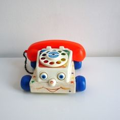 Téléphone Fisher Price. Its been sooo long since I've seen one of these!