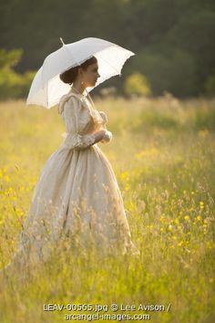 victorian woman alone in a summer meadow Photographer: Lee Avison