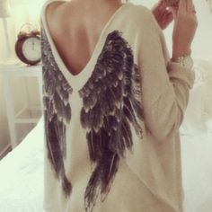 Stylish V-neck oversized sweater with printed wings at back