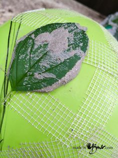 Super simple instructions with pictures to cast leaves on a sphere/orb using a concrete mix. Use as a candle holder, planter or orb.