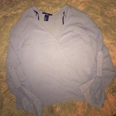H&M Baby Blue Long Sleeve Bouse sz 6 in Women's 100% Viscose. Worn once and never worn again which is reason why I'm selling it. Size Women's 6. Features button to close up plunge open cleavage or you can leave it open for a more sexy look. This shirt can be dressed up and dressed down. There are also buttons on sleeves to make them shorter or close them up. It is a pale blue color. H&M Tops Blouses