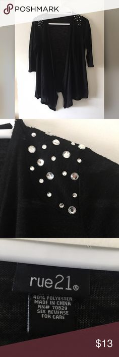 "Black embellished asymmetrical open cardigan Bundle and save 20% on 2+ items purchased and one shipping fee. Prices are firm unless bundled.  Condition - excellent preowned no flaws Color(s) - Black with crystals on front shoulder Style & Features - Light weight, elbow sleeves, open style knit cardigan with crystals on front upper shoulders; super cute. Material - polyester rayon blend Care - Hand washable Measurements (laying flat) - tag reads XL for juniors, bust 34"", asymmetrical length…"