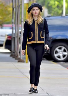 Suki suits up: Miss Waterhouse looked elegant in a black jacket with trim the colour of he...