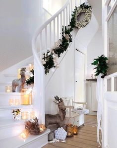 Adorn your staircase with silver trinkets and boughs of holly. Recreate this look by adding votive candles in little jars on the steps. You can put reindeers, wicker baskets or cut out snowflakes, too. For a more dramatic effect, you can place a Christmas wreath at the top of the stairs. But what really sold me here are the reindeers. Adorable!  Read more at: http://christmas.365greetings.com/christmas-decorations/christmas-decorations.html | Christmas Celebrations