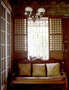 simple, low cost mirror flankedreclaimed capiz windows