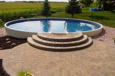 A Lakeville, Minnesota, Angie& List member improves his multi-generational home& outdoor entertainment space with a semi in-ground pool, firepit and patio upgrade, bringing enjoyment nearly year-round. Above Ground Fire Pit, Semi Above Ground Pool, In Ground Pools, Backyard Pool Landscaping, Backyard Pool Designs, Small Backyard Patio, Landscaping Ideas, Backyard Plan, Small Swimming Pools