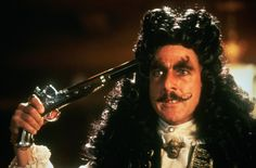Dustin Hoffman as Captain Hook in Hook (1991). If you watch the entire movie, he wears glasses and I image him in his pirate wig and glasses as King Vargan in the False Prince series