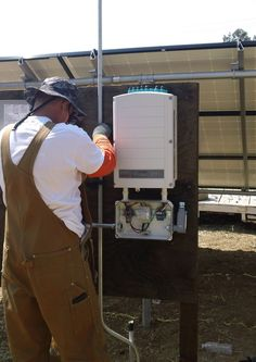 Working on the Solar panels electronics ( Vacaville California HVAC Solano Napa Fairfield Benicia Vallejo Suisun Green Energy ) Solar Panel Installation, Solar Panels, Vacaville California, Heating And Air Conditioning, Weather, Electronics, Green, Sun Panels, Solar Power Panels