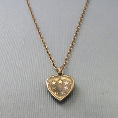 Starry Heart Necklace    by Natalie Tischler  Cast in brass from a vintage pendant and strung on an antiqued brass chain, the Starry Heart Necklace is just the thing to wear beneath a swirling sky on a starry night.