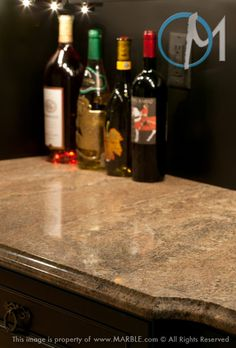 The gray and brown highlights in the Juparana Golden Vyara granite compliment the dark brown cabinets nicely.