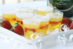 """CHAMPAGNE JELLO SHOTS!  """"Shopping List (Makes about 20 shots)   2 boxes of pineapple jello (4 serving size boxes)  1 1/2 cups boiling water  2 1/2 cups champagne  1 cup sliced strawberries  2 oz. plastic or glass shot glasses (mini champagne flutes would be adorable if you can find them)"""""""