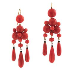 French Victorian Coral Pendant Earrings. French Victorian Coral Pendent Earrings, Ca '1890. These lovely matching very rich reddish-orange color coral earrings is exquisite, true vintage and classic girondelle designs with subtle seed pearl and black onyx accents, great easy to wear with more contemporary jewelry and a fabulous addition to any estate jewelry collection, French hallmarks, 18 karat gold