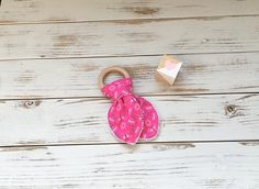 Welcome to MiLuv Boutique!  Our Bunny Ear Wooden Teething Rings are perfect for soothing sore gums. These are earth-friendly, stylish alternatives to plastic teething rings! The wooden ring measures 70mm in diameter and is made from natural wood that has no chemicals or treatments added, making it perfectly safe for babies to teethe on. And try wetting the ring and placing in the freezer for a few minutes to provide extra relief for your precious one! Wooden Teething Ring, Nursing Necklace, Terry Towel, Princess Collection, Wood Rings, Pink Butterfly, Natural Wood, Freezer, Wax