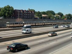 When they built the Eisenhower Expressway coming out from Chicago, it cut south Oak Park in half. One of OP's commuter trains runs right down the side of the highway.