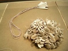 Pride of Paper: Not Just Another Collection of Paper Jewelry : TreeHugger. Use unusual materials for jewelry!