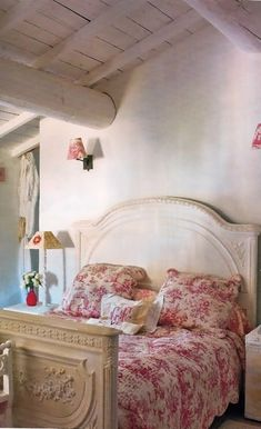 country french bedroom with red and white toile quilt