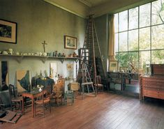 """Cezanne's studio in Aix-en-Provence, France Cezanne, like many artists, built a """"window wall"""" on the north side of his studio to take advantage of the diffused north light. The studio walls, which originally were white but interfered with the light, Cezanne painted the perfect shade of grey. He also had wooden floors he left unpolished so they wouldn't reflect the sunlight."""""""