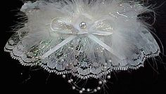Enchantment with Bits of Glitz. Deluxe Ivory KEEPSAKE Garter with floating pearls, marabou feathers, a satin band and matching bow. The ivory floret with a crystal rhinestone eye is in the center. Ivory Garters for Wedding Bridal Prom Fashion. Visit: www.garters.com/page21b.htm