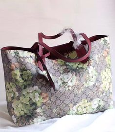 Gucci Reversible GG green blooms wine red leather tote.  See more Gucci handbags at http://www.luxtime.su/gucci-bags