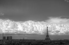 Cumulus congestus clouds and the Eifel Tower. A sign that fairly strong updrafts have formed and the atmosphere is conditionally unstable. ©Bertrand Kulik