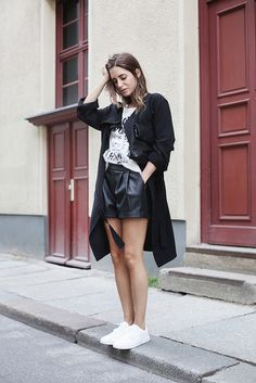 leather trousers with graphic top and black coat