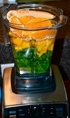 Mango green smoothie    Ingredients:  1-2 tablespoons flaxseed  1 cup coconut water  1 whole orange, peeled  3/4 cup frozen mango chunks  1/2 frozen banana  2-3 large handfuls of fresh organic spinach  Ice (until consistency you like)