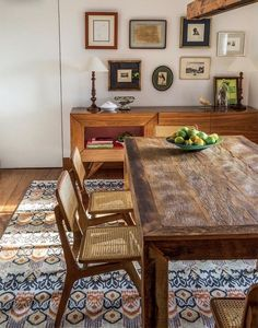 solid wood dining table and wicker chairs with colorful geo rug Kitchen Dinning, Dining Nook, Dining Room Design, Solid Wood Dining Table, Dinning Table, Sweet Home, Dinner Room, Dining Room Inspiration, Beautiful Kitchens