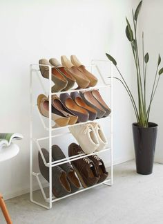 Packing 12 brilliant shoe storage ideas that will keep your footwear organized - Living in a shoebox Boot Storage, Corner Storage, Shoe Storage Cabinet, Storage Spaces, Slim Shoe Rack, Storage Design, Storage Ideas, Wall Mounted Shoe Rack, Cubby Shelves